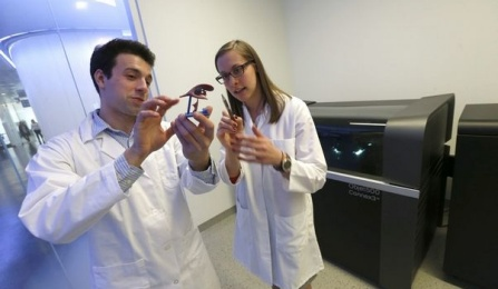 Richard Izzo, a UB graduate student, and Karen Meess, a Jacobs Institute biomedical engineer, discuss a printed 3D model of part of a brain. Robert Kirkham/Buffalo News