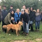 "AIChE Club Members on apple picking field trip with ""Cider"" the dog."