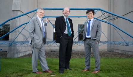 Photo of andrew whittaker michel bruneau and teng wu in front of steel bridge outside ketter hall