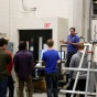 Photo of students and lab technician during materials steel testing