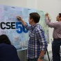 CSE 50th Anniversary participants sign the banner.