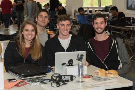 Meg Arnold (CS BS/MTH BS '17), Josh Bueno (CS BS '16), Alex Rookey (CS BS '16), and AJ Stohr (CS BS '16) at UB Hacking '15, November 14, 2015. Photo credit: Ken Smith.