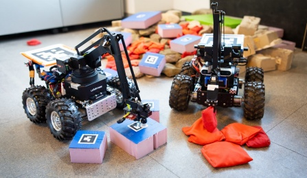 Two robots sort blocks and beanbags.