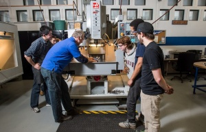 Students and machine shop staff work together in the Engineering Machine Shop.