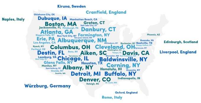 Word cloud with US cities in the shape of the US and international city names peppered around it.