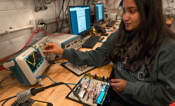 female student in electrical engineering tinkering lab.