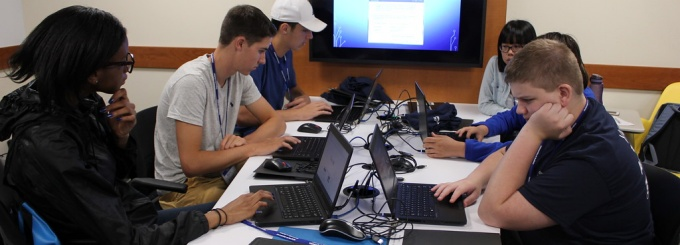 Students working on coding at UB North Campus.