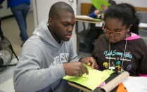 UB student working with high school student.