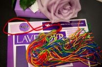 Lavender ceremony program and rainbow tassel.