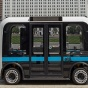 Autonomous shuttle driving along a citiscape