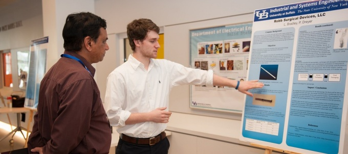 Robb Surgical Devices LLC. LBradley, P. Dreyer presenting their research at the 2014 design expo.