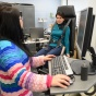 two female students working on workplace safety research in an ISE lab