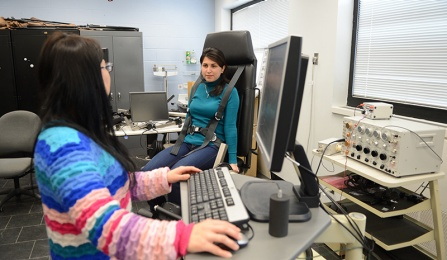 photo of two graduate students working in an ISE lab on workplace safety research