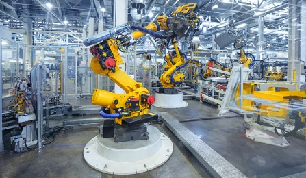 robotic arm on a production line in a car manufacturing facility