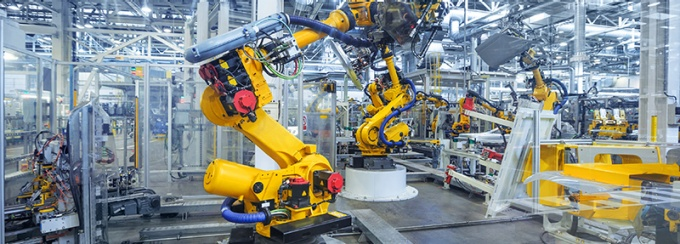 robots in a vehicle manufacturing facility
