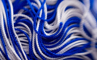 closeup image of blue and white graduation tassel.