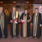 Michael Constantinou stands with the Rector and faculty members from University of Patras.