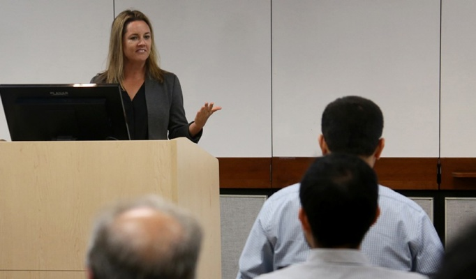 Kimberly Kurtis lectures faculty and graduate students behind a podium in Ketter Hall.