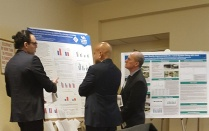 Abdulraham Hassaballah presents his research poster to a colleague