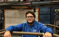 Zachary Vacek leans on steel bridge in the ASCE lab.