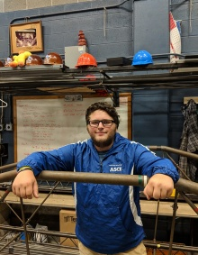 Zachary Vacek leans on steel bridge in UB ASCE lab
