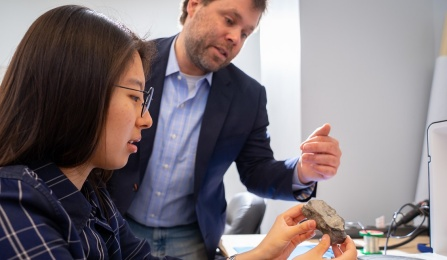 CSE Assistant Professor Nils Napp collaborates with a student in his Davis Hall lab. Photographer: Douglas Levere.