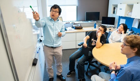 CSE Assistant Professor Shi Li instructs students in his Davis Hall office. Photographer: Douglas Levere.