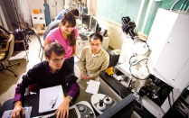 Five students at work in a university research lab.