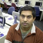 Shambhu Upadhyaya in his computer lab.