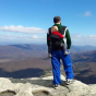 Ryan McLaughlin at the summit of a mountain.