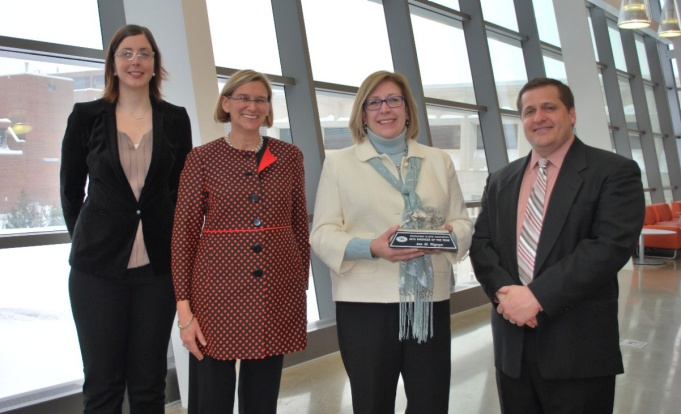 2015 Engineer of the Year Ann Wegrzyn (third from left) with Colleen O'Connell (BS CivE '03) EAA President, Liesl Folks, Dean of the School of Engineering and Applied Sciences and Matthew Sceusa, UB EAA board member.