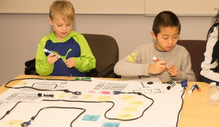At another demo, students learned how to make ozobots move by drawing their code on paper.