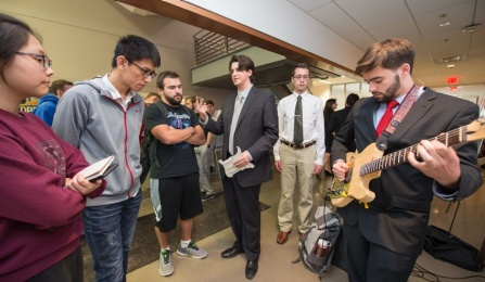 Students demonstrate electric guitar project.