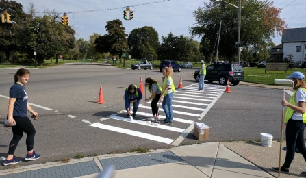 UB's IISE chapter members helping to paint crosswalks with GObike Buffalo.