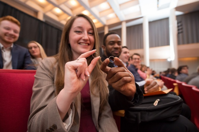 Students show off their rings, which symbolize their dedication to professional and ethical obligations as engineers. Photo credit: The Onion Studio.