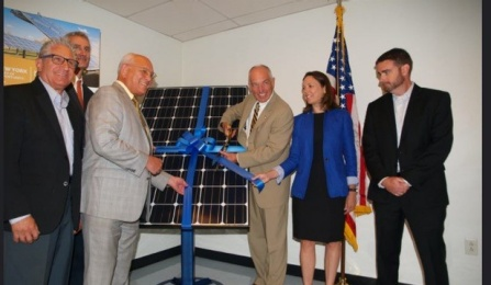 Scott Stevens, President of Dimension Fabricators, celebrates the installation of solar panels at the company.