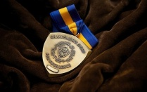 photo of SUNY Chancellor's award medal.