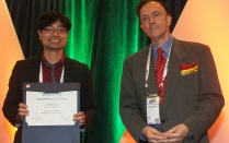 Jun Zhuang received the volunteer service award from INFORMS
