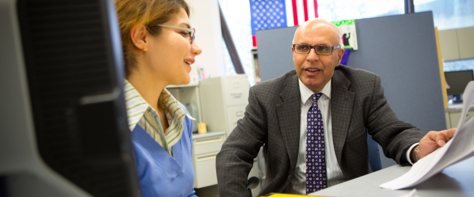 photo of Dr. Batta working with a graduate student.
