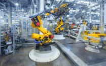 robots in a vehicle manufacturing facility.