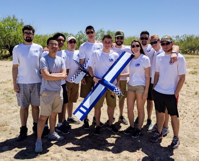 photo of AIAA students with an aircraft