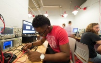 Student in the Electrical Tinker Shop.