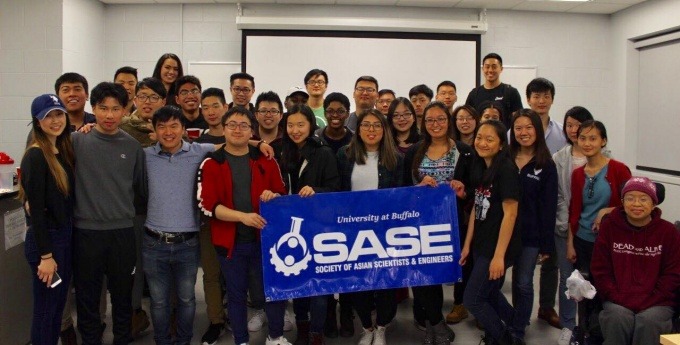 Photo of SASE members holding up their club sign