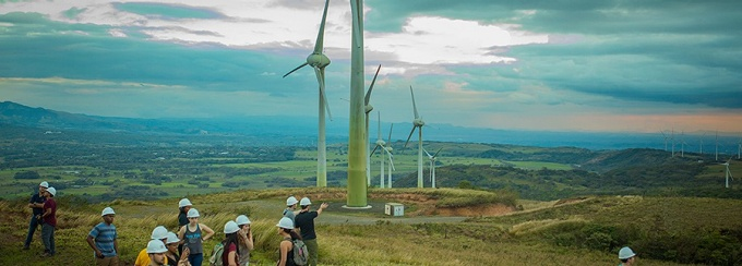 Students in Costa Rica looking at wind mills.