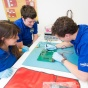 Three students work on an engineering intramural project.