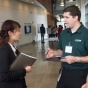 An engineering student talks to an employer at a career event.