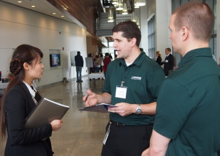 Student talks to a company at a career event.