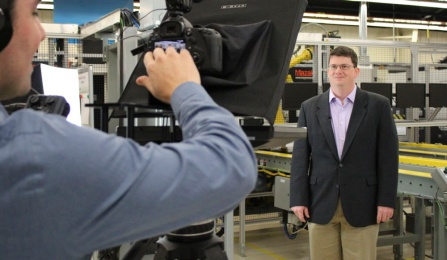 Kenneth English, PhD, deputy director of SMART at UB, films an introduction to one of the digital manufacturing and design courses at Moog, Inc. Behind the camera is J. Michael Vick, digital media producer at Full Circle Studios. Credit: Tracy Puckett.