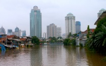 A view of downtown Jakarta and a nearby canal.