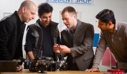 UB faculty working with robotics.